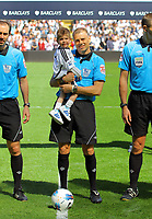 FAO SPORTS PICTURE DESK<br /> Pictured: Hari Kieft held by match referee M Halsey before kick off. Sunday, 13 May 2012<br /> Re: Premier League football, Swansea City FC v Liverpool FC at the Liberty Stadium, south Wales.