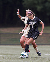 University of Central Florida midfielder Andrea Rodrigues (9) works to clear ball. After two overtime periods, Boston College tied University of Central Florida, 2-2, at Newton Campus Field, September 9, 2012.