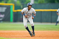 Leopoldo Correa (16) of the Princeton Rays takes his lead off of first base against the Burlington Royals at Burlington Athletic Park on July 5, 2013 in Burlington, North Carolina.  The Royals defeated the Rays 5-4 in game two of a doubleheader.  (Brian Westerholt/Four Seam Images)