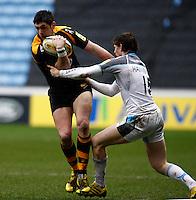 Photo: Richard Lane/Richard Lane Photography. Wasps v Newcastle Falcons. Aviva Premiership. 06/02/2016. Wasps' James Downey attacks as Falcons' Simon Hammersley tackles.