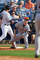 Detroit Tigers first baseman Will Allen (17) waits for a throw as pinch runner Tyler Wade (94) gets back to first during a Spring Training game against the New York Yankees on March 2, 2016 at George M. Steinbrenner Field in Tampa, Florida.  New York defeated Detroit 10-9.  (Mike Janes/Four Seam Images)