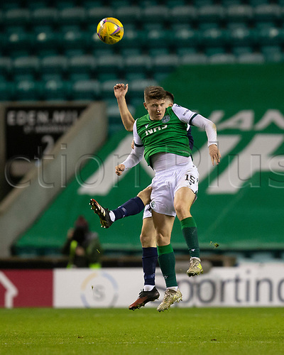 15th November 2020; Easter Road, Edinburgh, Scotland; Scottish League Cup Football, Hibernian versus Dundee FC; Kevin Nisbet of Hibernian competes in the air with Cammy Kerr of Dundee