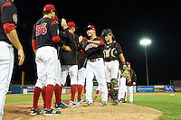 Batavia Muckdogs pitcher Steven Farnworth and catcher Blake Anderson go through the high five line after a win against the Mahoning Valley Scrappers on July 3, 2015 at Dwyer Stadium in Batavia, New York.  Batavia defeated Mahoning Valley 7-4.  (Mike Janes/Four Seam Images)