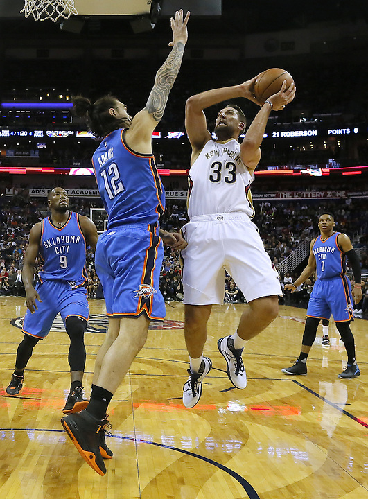 New Orleans Pelicans forward Ryan Anderson (33) drives to the basket against Oklahoma City Thunder center Steven Adams (12) during the first half of an NBA basketball game Thursday, Feb. 25, 2016, in New Orleans. (AP Photo/Jonathan Bachman)