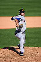 Salt River Rafters pitcher Kyle Regnault (28) delivers a pitch during an Arizona Fall League game against the Surprise Saguaros on October 20, 2015 at Salt River Fields at Talking Stick in Scottsdale, Arizona.  Surprise defeated Salt River 3-1.  (Mike Janes/Four Seam Images)