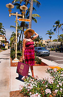 Woman shopping in stylish Naples Florida on trendy 5th Avenue with shopping bag