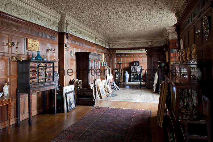 Elaborate plasterwork friezes and a patterned ceiling adorn the Tudor long gallery which houses many pieces of oak furniture from the same period