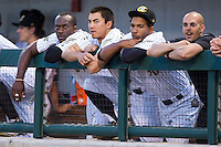 (L-R) Jared Mitchell (21), Tyler Saladino (8) and Frank De Los Santos (30) watch the action from the dugout during the game against the Lehigh Valley IronPigs at BB&T Ballpark on May 8, 2014 in Charlotte, North Carolina.  The IronPigs defeated the Knights 8-6.  (Brian Westerholt/Four Seam Images)