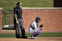 High Point Panthers catcher Spencer Brown (26) looks to the dugout for the pitch call during the game against the NJIT Highlanders at Williard Stadium on February 19, 2017 in High Point, North Carolina. The Panthers defeated the Highlanders 6-5. (Brian Westerholt/Four Seam Images)