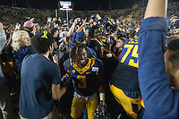 BERKELEY, CA - September 17, 2016: Cal players and fans celebrate their victory over Texas at Cal Memorial Stadium.