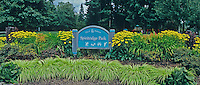 Panoramic of Spiritridge Park Entrance Sign with flowers and plants, Bellevue, Washington.