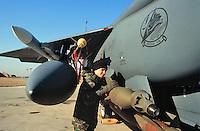 """- Deny Flight NATO operation over former Yugoslavia, In October 1992 NATO forces begin to control the aerial space above the Bosnia-Herzegovina, laser guided bombs are loaded on a F 15E """"Strike Eagle""""  fighter-bomber in the US air base  of Aviano (Pordenone, Italy)<br /> <br /> - Operazione Deny Flight sulla ex Yugoslavia , nell'ottobre del 1992 le forze della NATO incominciano il controllo dello spazio aereo sulla Bosnia-Erzegovina,  bombe a guida laser vengono caricate su un  cacciabombardiere F 15E """"Strike Eagle""""  nella base USA di Aviano (Pordenone)"""