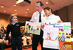 WATERBURY, CT. 03 January 2007--010307SV01--Lt. Tom Varanelli of the Fire Marshal's office congratulates the first place poster contest winners, 4th grader Rachael Pettinicchi of St. Mary's School, and 5th grader Justin Byers of Hopeville School during a ceremony at the marshal's office in Waterbury Wednesday.<br /> Steven Valenti Republican-American