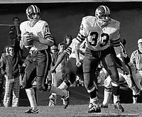 Joe Theismann Toronto Argonauts Quarterback, Bill Symons fullback 1971. Copyright photograph Scott Grant