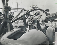1967 FILE PHOTO - ARCHIVES -<br /> <br /> Bigger than Disneyland; La Ronde is children's paradise. Daniella and Bobby Plante take a trip on one of the many thrill rides<br /> <br /> 1967<br /> <br /> PHOTO : Boris Spremo - Toronto Star Archives - AQP