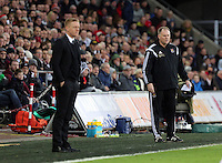 Pictured L-R: Swansea manager Garry Monk and West Ham manager Neil McDonald Saturday 10 January 2015<br /> Re: Barclays Premier League, Swansea City FC v West Ham United at the Liberty Stadium, south Wales, UK