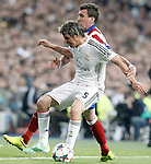 Real Madrid's Fabio Coentrao (f) and Atletico de Madrid's Mario Mandzukic during Champions League 2014/2015 Quarter-finals 2nd leg match.April 22,2015. (ALTERPHOTOS/Acero)