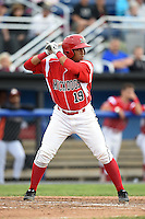 Batavia Muckdogs catcher Luis Alberto Sanz (19) at bat during a game against the Mahoning Valley Scrappers on June 20, 2014 at Dwyer Stadium in Batavia, New York.  Batavia defeated Mahoning Valley 7-4.  (Mike Janes/Four Seam Images)