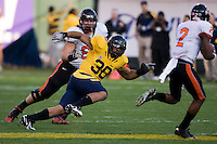 November 12th, 2011:  Mychal Kendricks of California tries to tackle Oregon State's Markus Wheaton during a game at AT&T Park in San Francisco, Ca  -  California defeated Oregon State 23- 6.