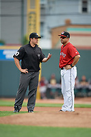 Erie SeaWolves coach Mike Rabelo (58) argues a call with umpire Mike Savakinas during an Eastern League game against the Altoona Curve on June 5, 2019 at UPMC Park in Erie, Pennsylvania.  Altoona defeated Erie 6-2.  (Mike Janes/Four Seam Images)