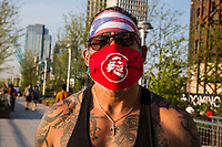 NEW YORK, NY - MAY 15: A man wears a face mask and the Puerto Rican flag on his head visit Domino Park on May 15, 2020 in Brooklyn, NY. COVID-19 has spread to most countries in the world, claiming more than 303,000 infected lives for more than 4.5 million people, although in some cities the pandemic has controlled deaths and infections continue. Mayor Bill de Blasio says the city, along with New York police, will launch a pilot program in public parks this weekend to monitor crowds (Photo by Pablo Monsalve / VIEWpress via Getty Images)
