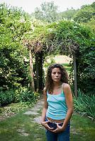 Woman standing near a gazebo