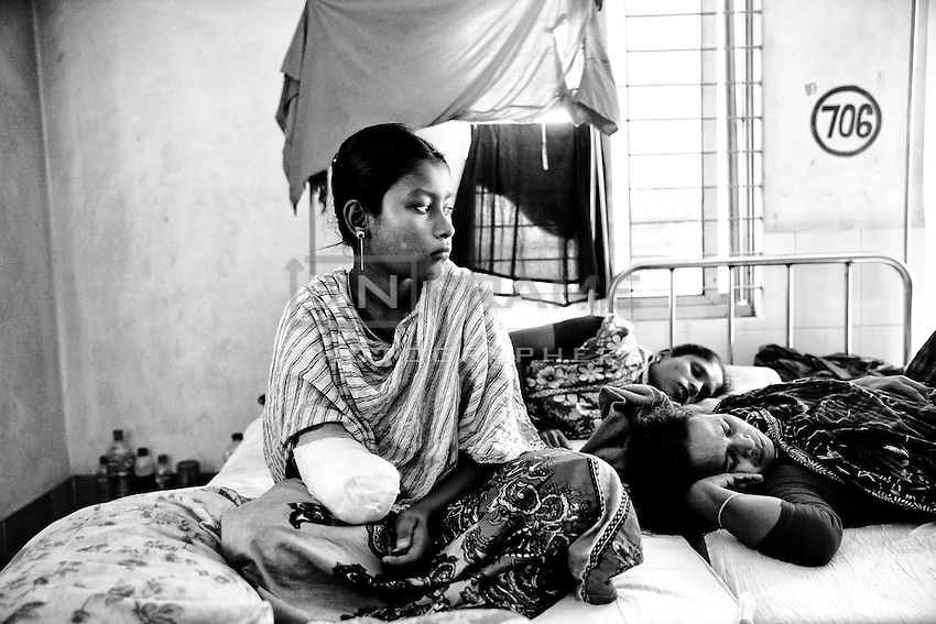 Bangladeshi garment worker Anna, 16, who worked on the 5th floor of Rana Plaza at Enam Medical College, in Savar, near Dhaka, Bangladesh. Anna had her right arm amputated to free her from the rubble when she was rescued nearly 48 hours after the building collapsed.