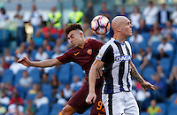 Calcio, Serie A: Roma vs Udinese. Roma, stadio Olimpico, 20 agosto 2016.<br /> Roma's Stephan El Shaarawy, left, and Udinese's Emil Hallfredsson jump for the ball during the Italian Serie A football match between Roma and Udinese at Rome's Olympic Stadium, 20 August 2016. Roma won 4-0.<br /> UPDATE IMAGES PRESS/Riccardo De Luca