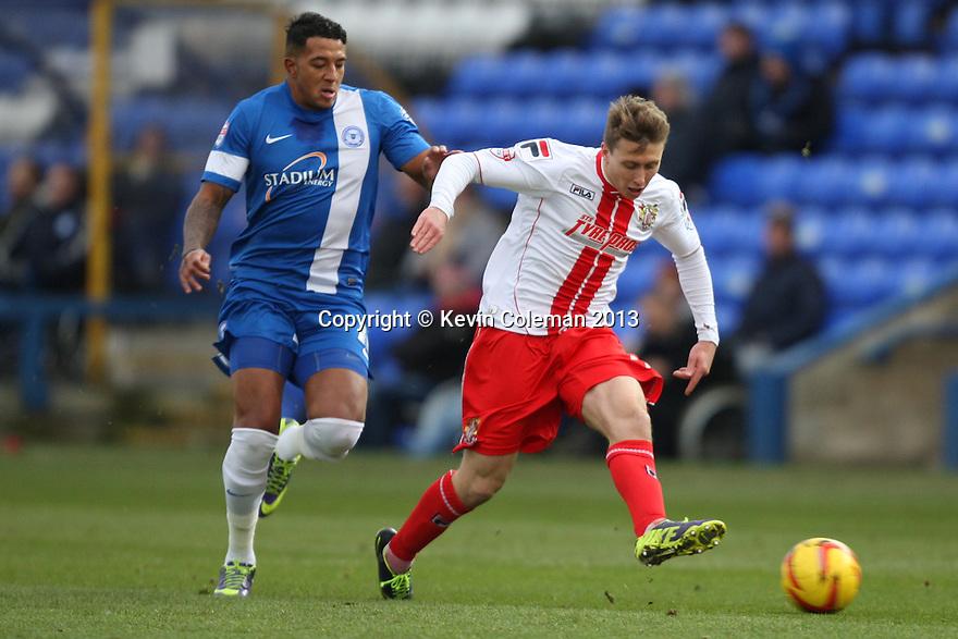 Luke Freeman of Stevenage escapes from Nathaniel Mendez-Laing of Peterborough<br />  - Peterborough United v Stevenage - Sky Bet League One - London Road, Peterborough - 23rd November 2013. <br /> © Kevin Coleman 2013