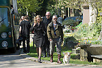 The funeral of the late music manager and punk pioneer Malcolm McLaren in London this afternoon. Ben Westwood leaving the cemetary with a dog. He is wearing a t-shirt with the slogan Free Leonard Peltier, which are the last words Malcolm McLaren uttered before he passed away..