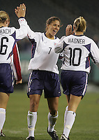06 November,  2004.   Shannon Boxx (7) celebrates a US goal with Abby Wambach (16) and Aly Wagner (10) at  Lincoln Financial Field in Philadelphia, Pa.