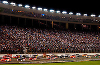 NASCAR Winston Cup driver Tony Stewart leads the field down the front stretch during a caution flag lap during the running of the Winston at Lowe?s Motor Speedway.