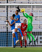 ORLANDO, FL - FEBRUARY 24: Bruna #3 of Brazil goes up for a header against Stephanie Labbe #1 of Canada during a game between Brazil and Canada at Exploria Stadium on February 24, 2021 in Orlando, Florida.