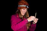 Mountain Lion (Puma concolor) biologist, Justine Alyssa Smith, preparing anesthesia needle to sedate sub-adult male for collaring, Santa Cruz Puma Project, Santa Cruz, Monterey Bay, California