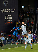 KANSAS CITY, KS - MAY 29: Fafa Picault #10 of Houston Dynamo FC and Johnny Russell #7 of Sporting KC fight for a header during a game between Houston Dynamo and Sporting Kansas City at Children's Mercy Park on May 29, 2021 in Kansas City, Kansas.