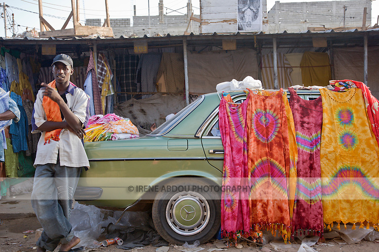 The HLM Market in Dakar, Senegal sells all kinds of colorful cloths.  Many of the vendors come here from Guinea.
