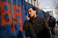 Han Chinese walk past a demolition site on the edge of the Old City in Kashgar, Xinjiang, China.
