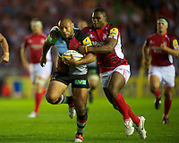Jordan Turner-Hall of Harlequins is tackled by Joe Ajuwa of London Welsh during the Aviva Premiership match between Harlequins and London Welsh at the Twickenham Stoop on Friday 7th September 2012 (Photo by Rob Munro)