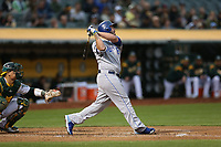 OAKLAND, CA - AUGUST 14:  Mike Moustakas #8 of the Kansas City Royals bats against the Oakland Athletics during the game at the Oakland Coliseum on Monday, August 14, 2017 in Oakland, California. (Photo by Brad Mangin)