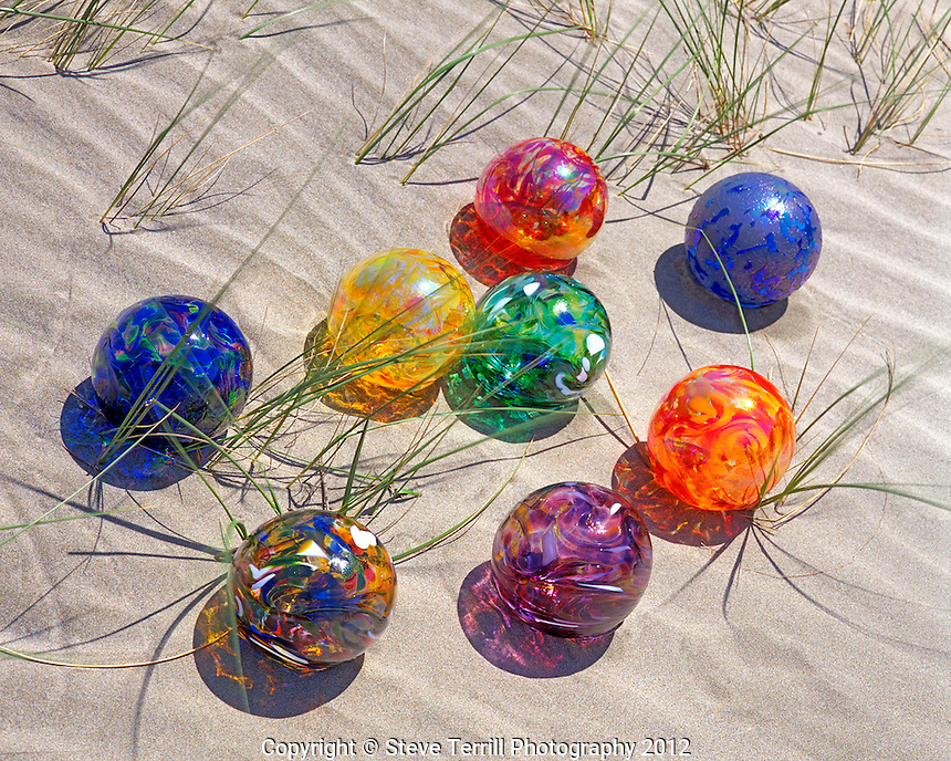 Glass floats on sand dune