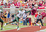 Florida State wide receiver Jesus Wilson goes up for a 23 yard touchdown pass over South Florida's Johnny Ward inthe 3rd quarter of an NCAA college football game in Tallahassee, Fla., Saturday, Sept. 12, 2015. The FSU Seminoles defeated the South Florida Bulls 34-14.