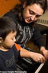Education elementary school Grade Kindergaten school for musically gifted children boy in piano lesson with female teacher