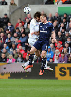 Pictured L-R: Michu of Swansea clashes for a header against Scott Parker of Tottenham. Saturday 30 March 2013<br /> Re: Barclay's Premier League, Swansea City FC v Tottenham Hotspur at the Liberty Stadium, south Wales.