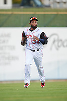 Arkansas Travelers left fielder Keury De La Cruz (34) jogs back to the dugout during a game against the Midland RockHounds on May 25, 2017 at Dickey-Stephens Park in Little Rock, Arkansas.  Midland defeated Arkansas 8-1.  (Mike Janes/Four Seam Images)