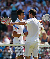 England, London, 28.06.2014. Tennis, Wimbledon, AELTC, Men's semifinal between Novak Djokovic  (SRB) and Grigor Dimitrov (BUL), Pictured: Novak Djokovic receives congrets  after defeating Dimitrov (R)<br /> Photo: Tennisimages/Henk Koster