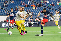 FOXBOROUGH, MA - MAY 16: Gustavo Bou #7 of New England Revolution takes a shot on Columbus SC goal during a game between Columbus SC and New England Revolution at Gillette Stadium on May 16, 2021 in Foxborough, Massachusetts.
