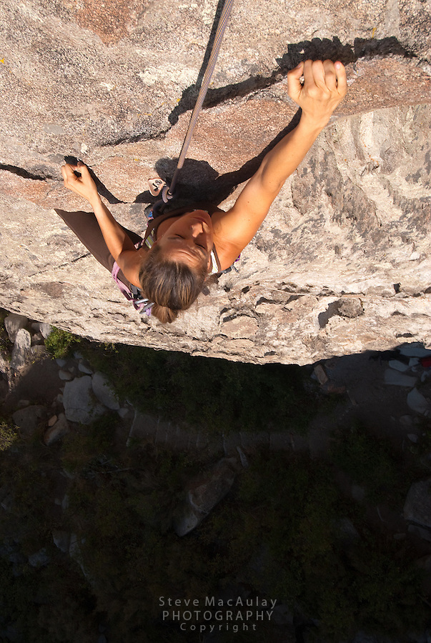 Overhead view of young woman rock climbing at Castle Rocks State Park, Idaho