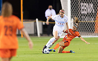 HOUSTON, TX - APRIL 09: Shea Groom #6 of the Houston Dash kicks the ball away from Kayla Sharples #28 of the Chicago Red Stars during a game between Chicago Red Stars and Houston Dash at BBVA Stadium on April 09, 2021 in Houston, Texas.