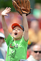 Erie Seawolves young fan trying to catch a free giveaway from the team staff in between innings during a game against the New Hampshire Fisher Cats on June 9, 2013 at Jerry Uht Park in Erie, Pennsylvania.  New Hampshire defeated Erie 3-2.  (Mike Janes/Four Seam Images)