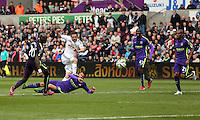SWANSEA, WALES - MAY 17: Gylfi Sigurdsson of Swansea (2nd L) scores during the Premier League match between Swansea City and Manchester City at The Liberty Stadium on May 17, 2015 in Swansea, Wales. (photo by Athena Pictures/Getty Images)